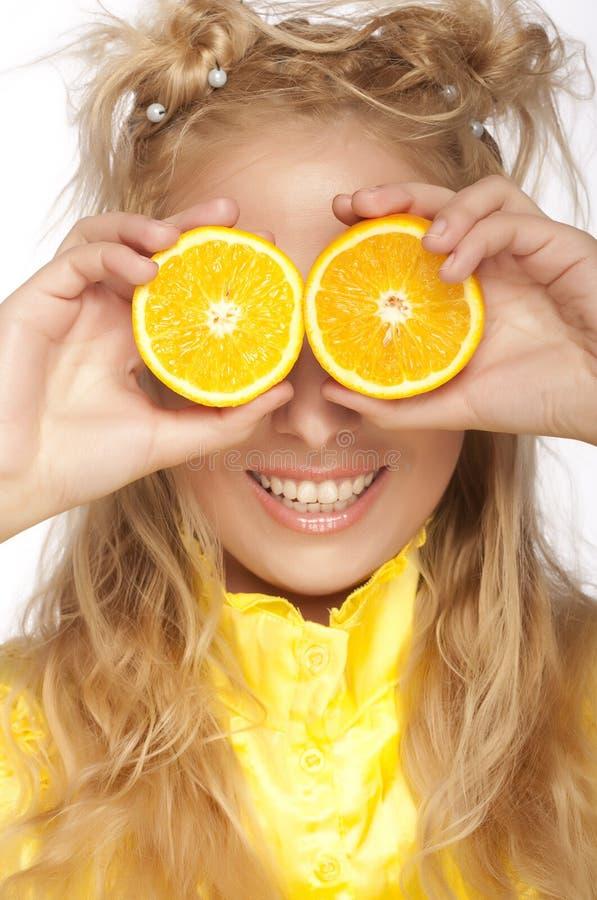 Schönes Frau `s Gesicht mit Orange lizenzfreie stockfotografie