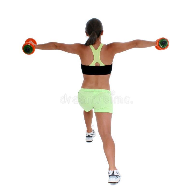Schönes jugendlich Mädchen in der Trainings-Kleidung, die Laufleine zeigt stockbild