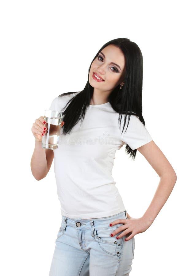 Schönes junges Mädchen und Glas Wasser stockbild