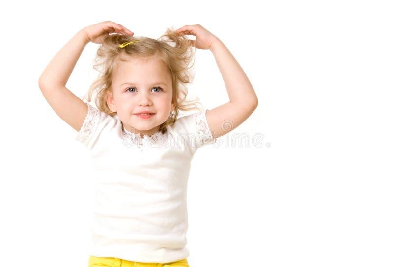 Schönes kleines Mädchen auf weißem Hintergrund stockfoto
