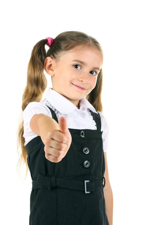 Schönes kleines Mädchen in der Schuluniform lizenzfreie stockbilder