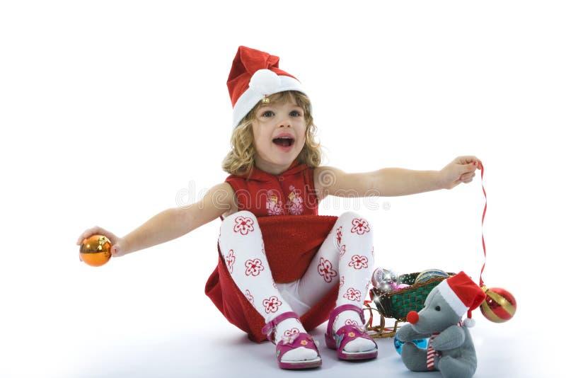 Schönes kleines Mädchen mit Weihnachtsdekoration stockbild