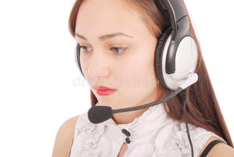 Schönes Kundendienst-Betreiberstudentenmädchen mit headse lizenzfreie stockbilder
