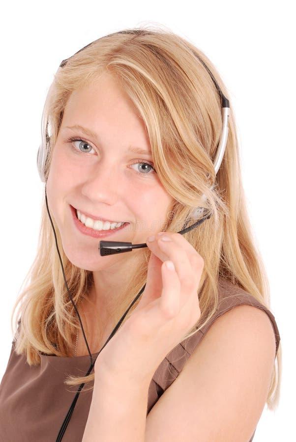 Schönes Kundendienst-Betreiberstudentenmädchen mit Kopfhörer stockfotos