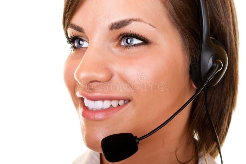 Schönes Kundendienstmädchen mit Kopfhörer lizenzfreies stockbild