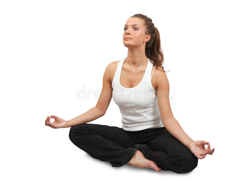 Schönes Mädchen, das Yoga tut. stockfotos