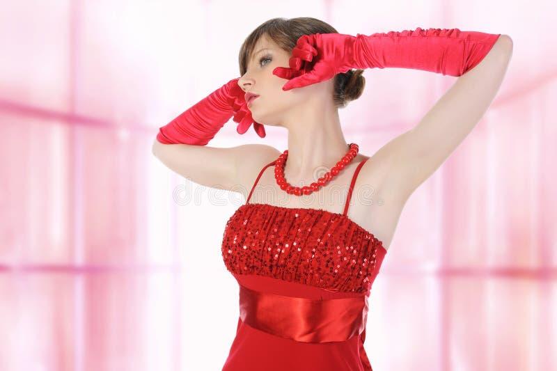 Schönes Mädchen in den roten Handschuhen. lizenzfreies stockfoto