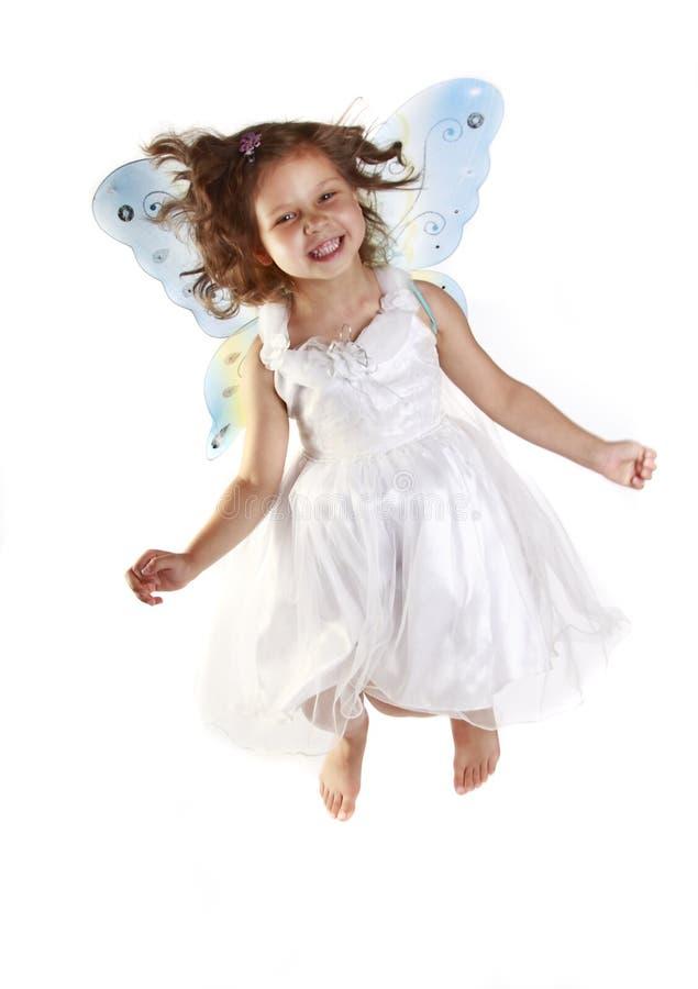 Schönes Mädchen in einem feenhaften Kostüm mit Basisrecheneinheit w stockfotografie