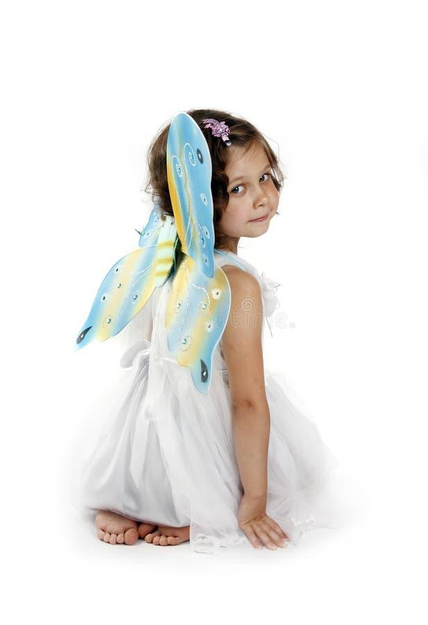 Schönes Mädchen in einem feenhaften Kostüm mit Basisrecheneinheit w stockbilder