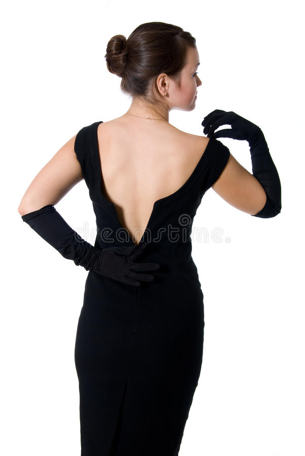 Schönes Mädchen in einem Kleid mit einem geöffneten zurück stockbilder