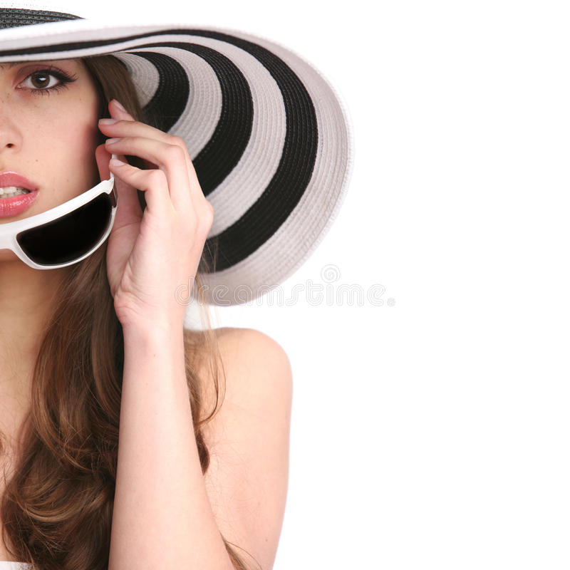 Schönes Mädchen in gestreiftem Hut stockbild