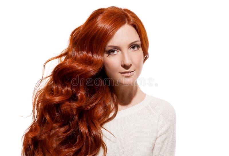 Schönes Mädchen. Gesundes langes Haar. Weißer Hintergrund lizenzfreie stockfotos