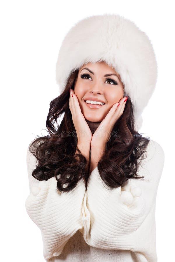 Schönes Mädchen im Pelz-Hut. lizenzfreies stockbild