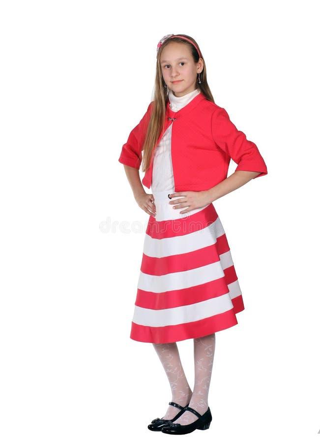 Schönes Mädchen im roten Kleid lizenzfreies stockfoto