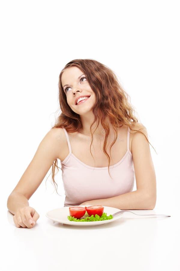 Schönes Mädchen isst zu Abend lizenzfreie stockbilder