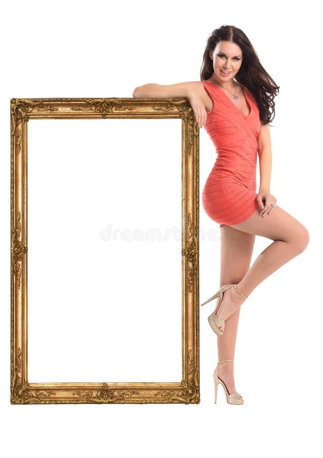 Schönes Mädchen mit dem Bilderrahmen lokalisiert auf Weiß lizenzfreies stockbild
