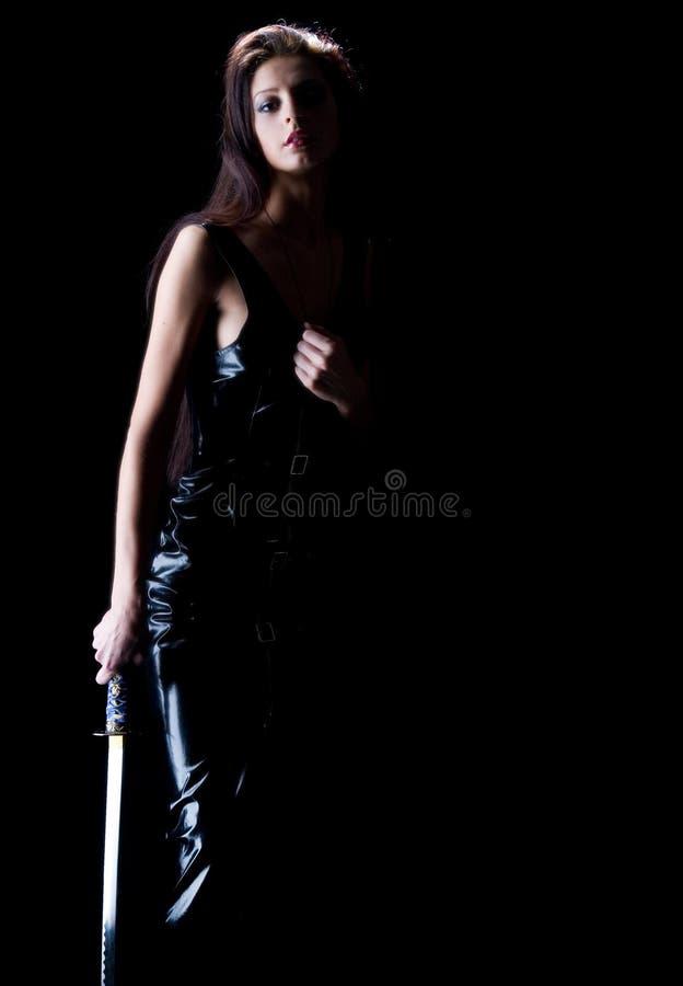 Schönes Mädchen mit einer Klinge lizenzfreie stockbilder