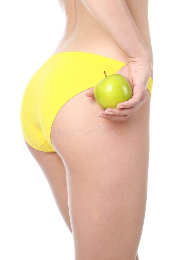 Schönes Mädchen mit grünem Apfel. lizenzfreies stockbild
