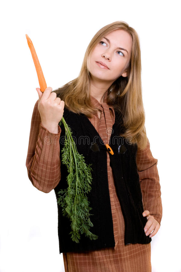Schönes Mädchen mit Karotte stockbilder