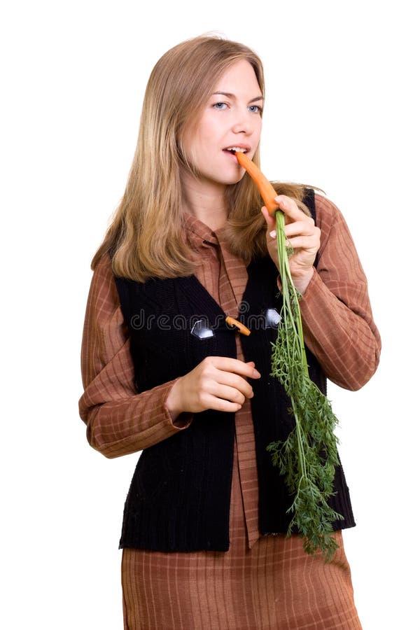 Schönes Mädchen mit Karotte lizenzfreies stockfoto