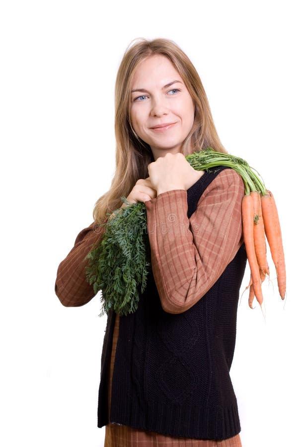 Schönes Mädchen mit Karotte lizenzfreie stockfotografie