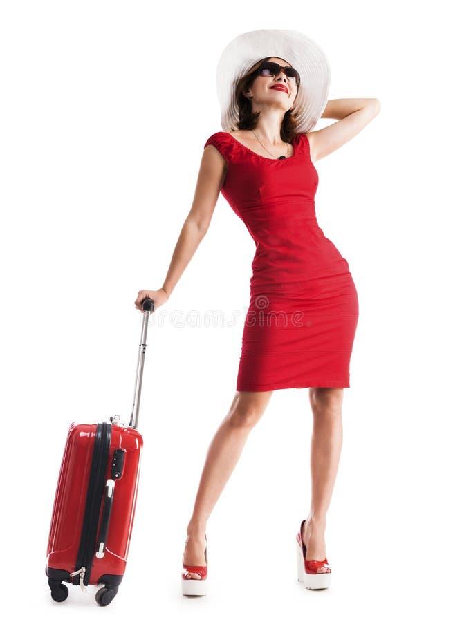 Schönes Mädchen mit Koffer stockbild