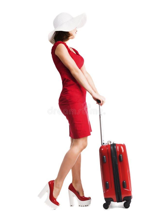 Schönes Mädchen mit Koffer lizenzfreie stockfotografie