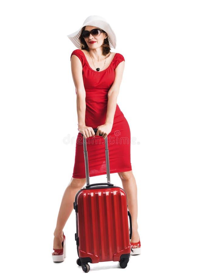 Schönes Mädchen mit Koffer lizenzfreies stockbild