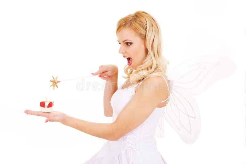 Schönes Mädchen mit magischem Stab stockfotografie