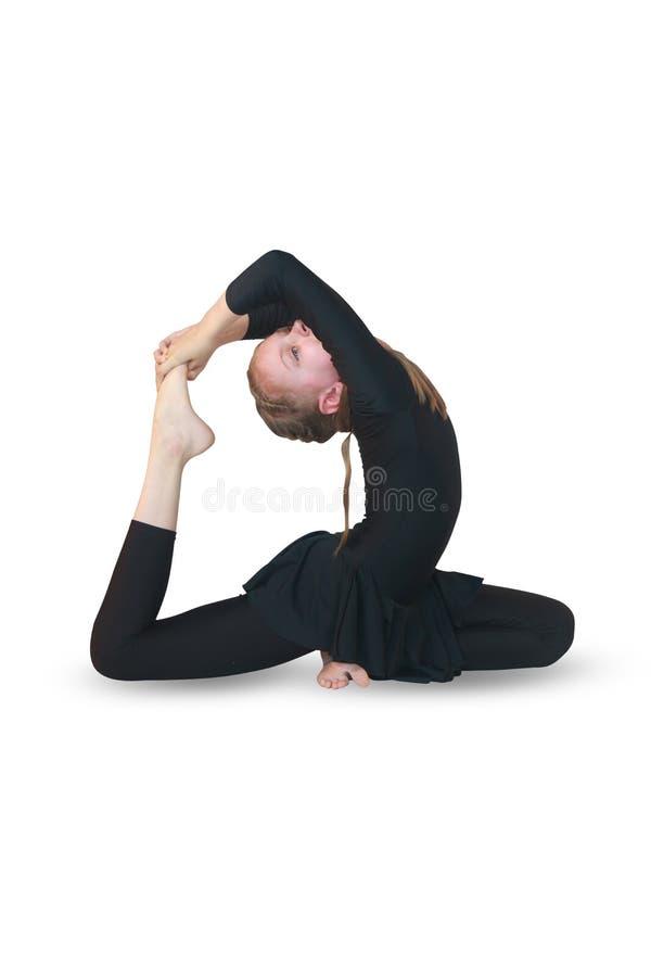 Schönes Mädchen nimmt an Yoga auf ackground teil lizenzfreie stockfotografie