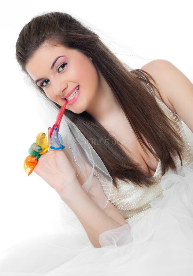 Schönes Mädchen Und Kondome Stockfoto - Bild von kleid