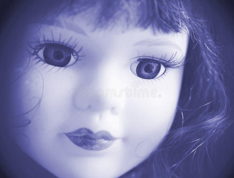 Schönes Puppegesicht im Blau. lizenzfreies stockbild
