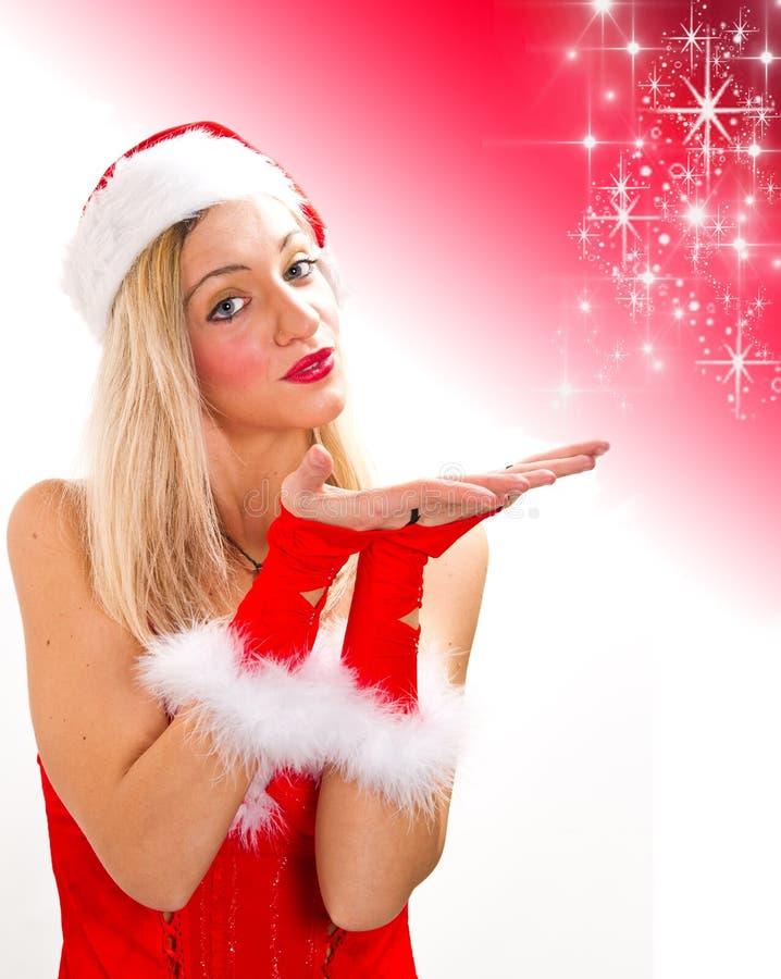 Schönes reizvolles Mädchen, das Weihnachtsmann-Kleidung trägt lizenzfreies stockfoto