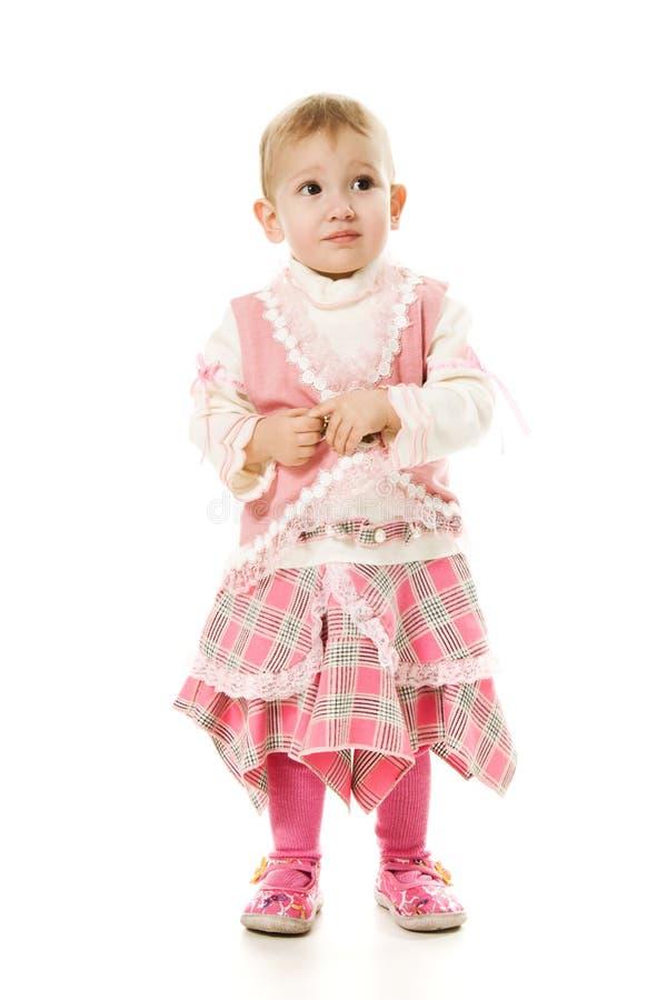 Schönes Schätzchen in einem rosafarbenen Kleid stockbild
