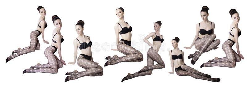Schönheit mit den langen sexy Beinen in den Strümpfen lizenzfreie stockbilder