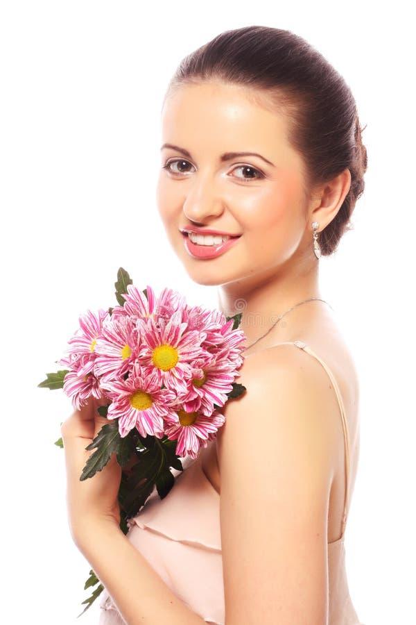Schönheit mit den rosa Blumen lokalisiert auf Weiß stockfotos