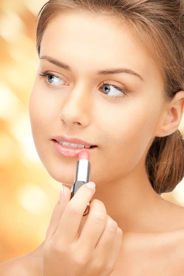 Schönheit mit Lippenstift stockfotografie