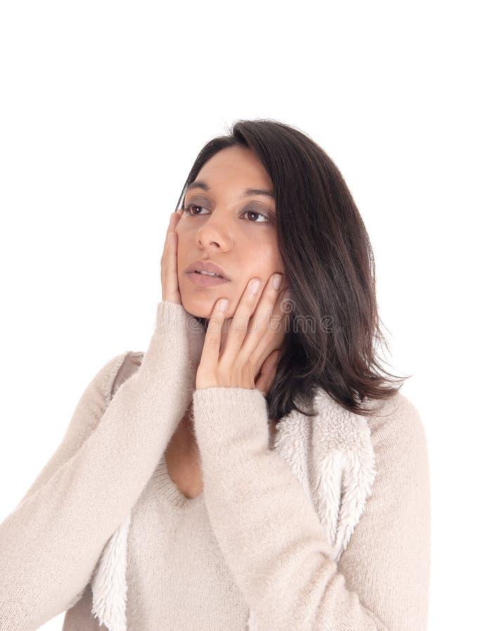 Schönheit Whit ihre Hände auf ihrem Gesicht lizenzfreie stockfotografie