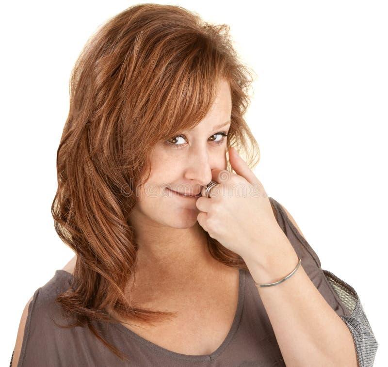 Schüchterne Dame With Hand Near Mouth lizenzfreie stockbilder