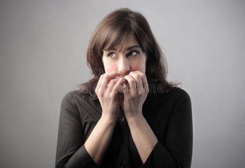 Schüchterne Frau stockfotografie