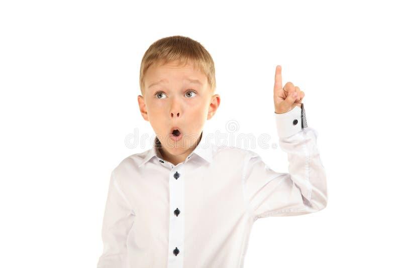 Schüler ist überrascht, seinen Finger oben zu zeigen stockbilder