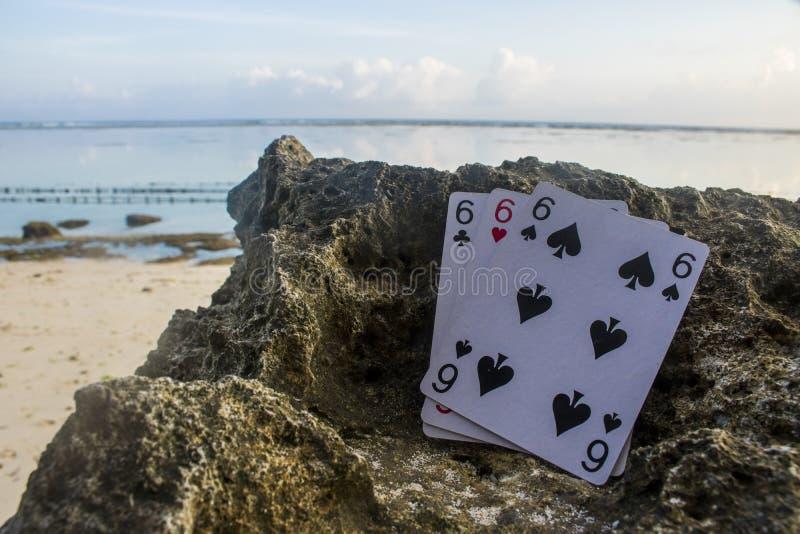 Schürhakenkarten-Glücksspieldrilling dreifaches sechs stockfotografie