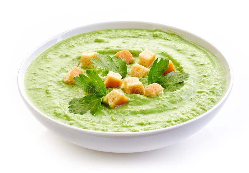Schüssel Brokkoli und grüne Erbsen sahnen Suppe lizenzfreie stockfotografie