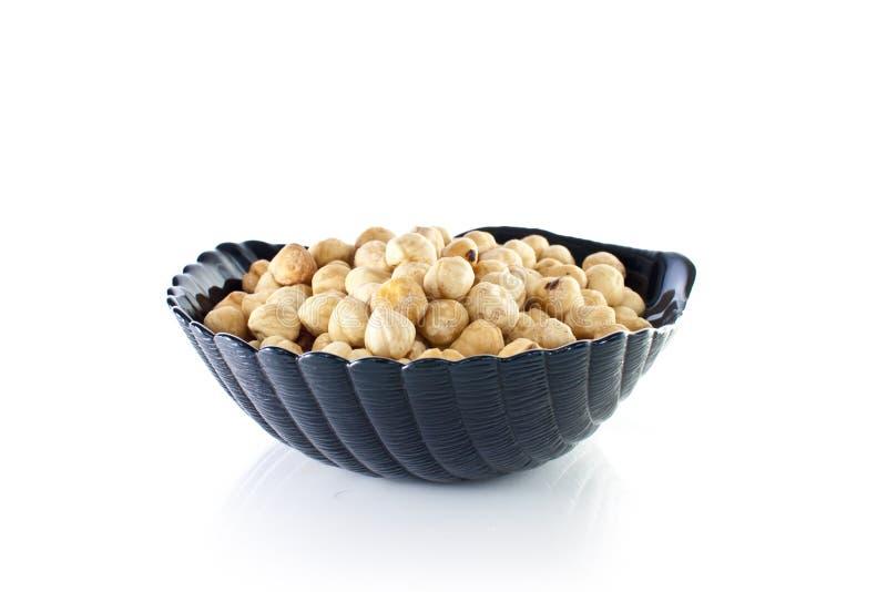 Schüssel Macadamiamuttern stockbilder