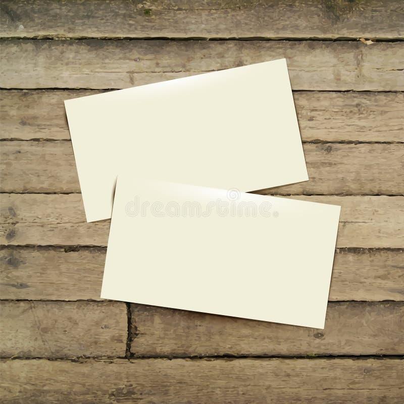 Schablonen-weiße Visitenkarte auf dem Holztisch stock abbildung