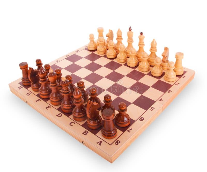 Schach auf einem Schachvorstand auf weißem Hintergrund stockbild