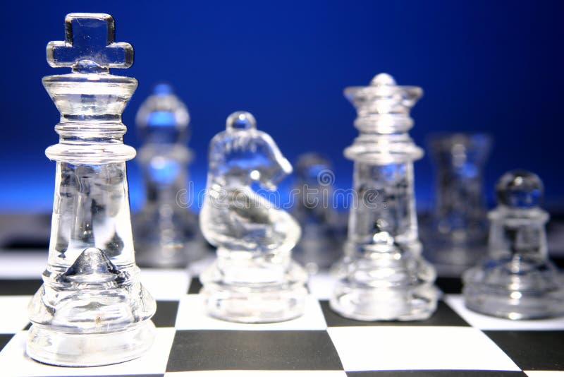 Schach-Stücke an Bord stockfotografie
