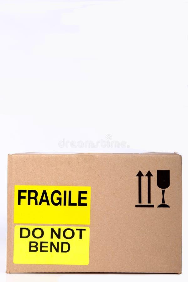 Schachtel mit gelblich zerbrechlicher Verpackung und nicht kleben lizenzfreie stockfotografie