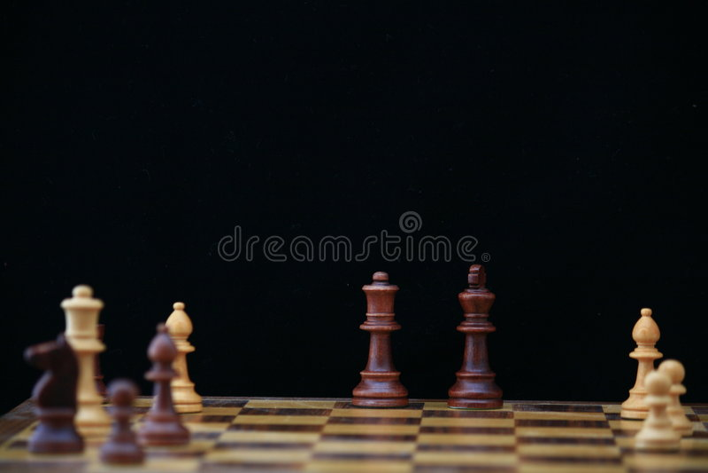 Schachvorstand mit König u. Königin stockbilder