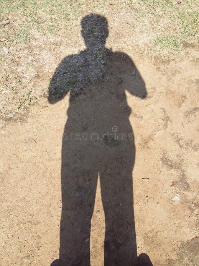 schaduw van de vette mens stock afbeeldingen